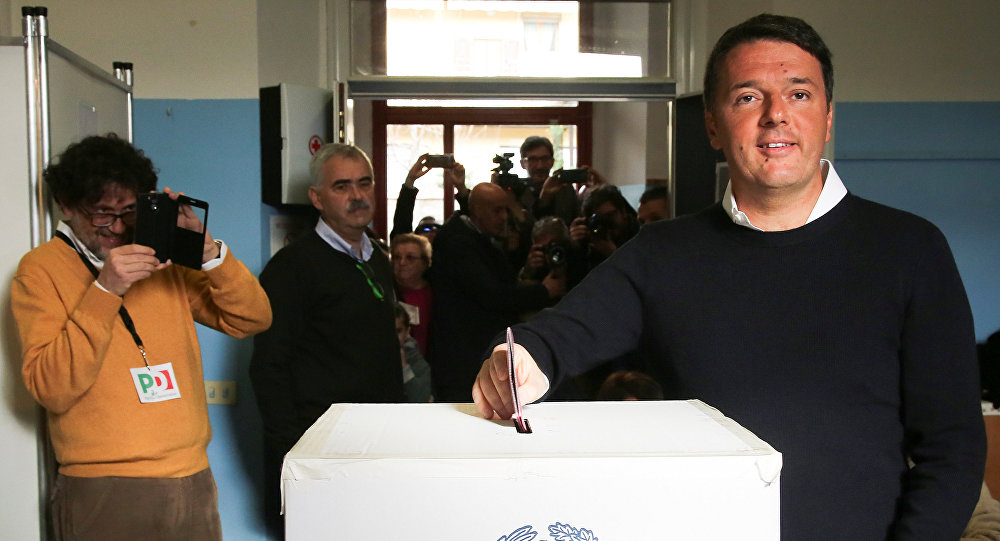 Italian Prime Minister Matteo Renzi casts his vote for the referendum on constitutional reform, in Pontassieve, near Florence, northern Italy December 4, 2016
