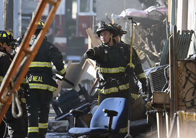 Firefighters assess the scene where a deadly fire tore through a late-night electronic music party in a warehouse in Oakland, Calif., Saturday, Dec. 3, 2016. Officials described the scene inside the warehouse, which had been illegally converted into artist studios, as a death trap that made it impossible for many partygoers to escape the Friday night fire.