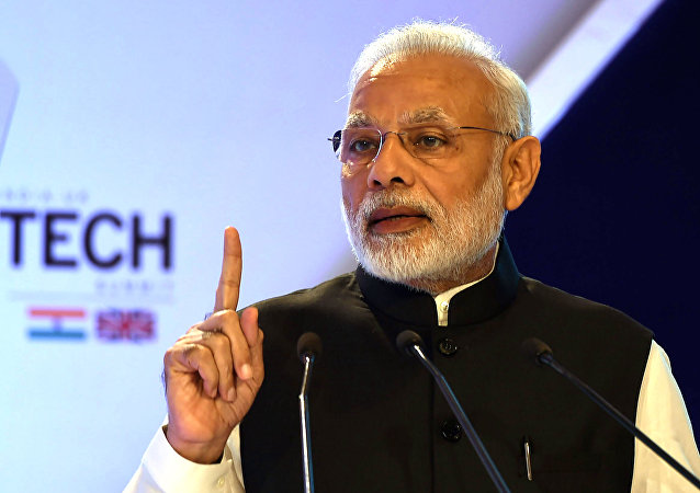 India's Prime Minister Narendra Modi gestures as he speaks at The India-UK Tech Summit in New Delhi on November 7, 2016