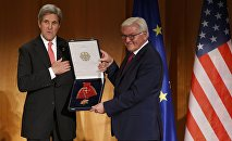 U.S. Secretary of State John Kerry receives the Grand Cross, First Class of the order of Merit of the Federal Republic of Germany from German Foreign Minister Frank-Walter Steinmeier (R) at the Foreign Ministry in Berlin, Germany, December 5, 2016.