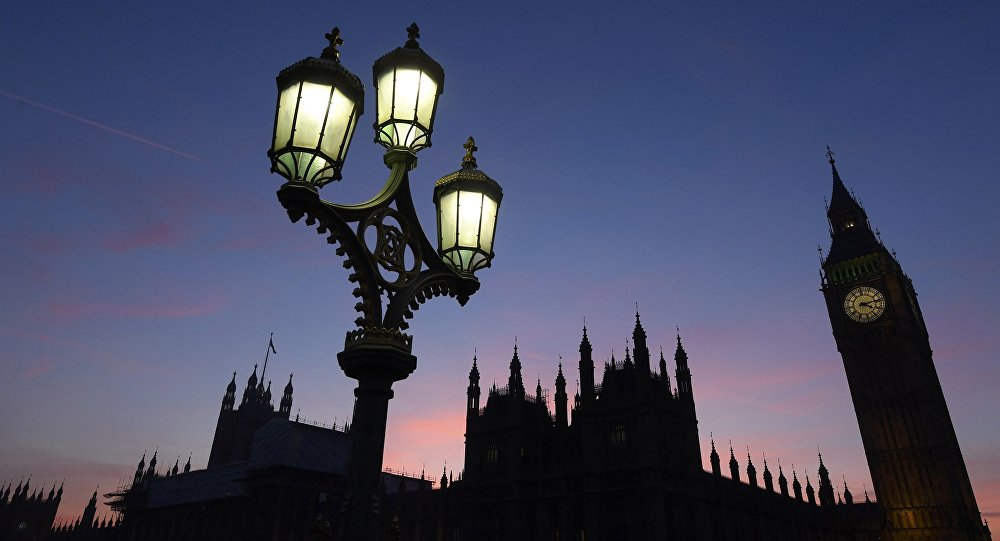 Dusk falls behind the Houses of Parliament on a clear evening in Westminster, central London, Britain December 5, 2016.
