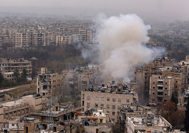 Smoke rises near Bustan al-Qasr crossing point in a government controlled area, during clashes with rebels in Aleppo, Syria December 5, 2016.
