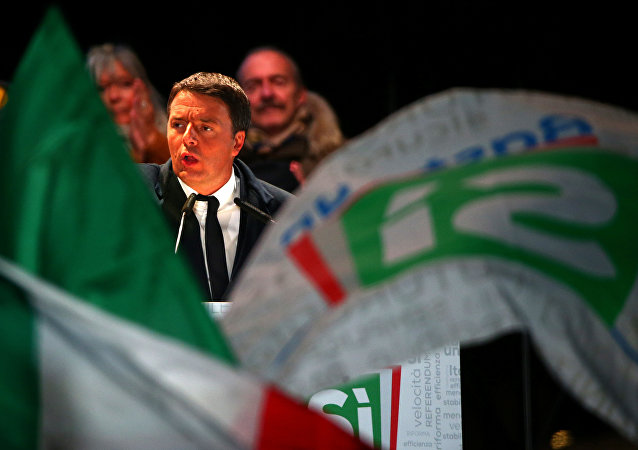 Italian Prime Minister Matteo Renzi speaks during the last rally for a Yes vote in the upcoming referendum about constitutional reform, in Florence, Italy