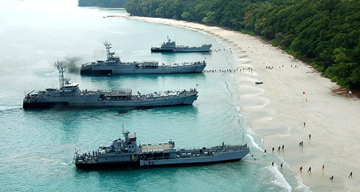 Kumbhir-class L-21 and L-22 LSTs (in the middle), and L-32, L-34 LCUs of the Indian Navy beached during an amphibious landing