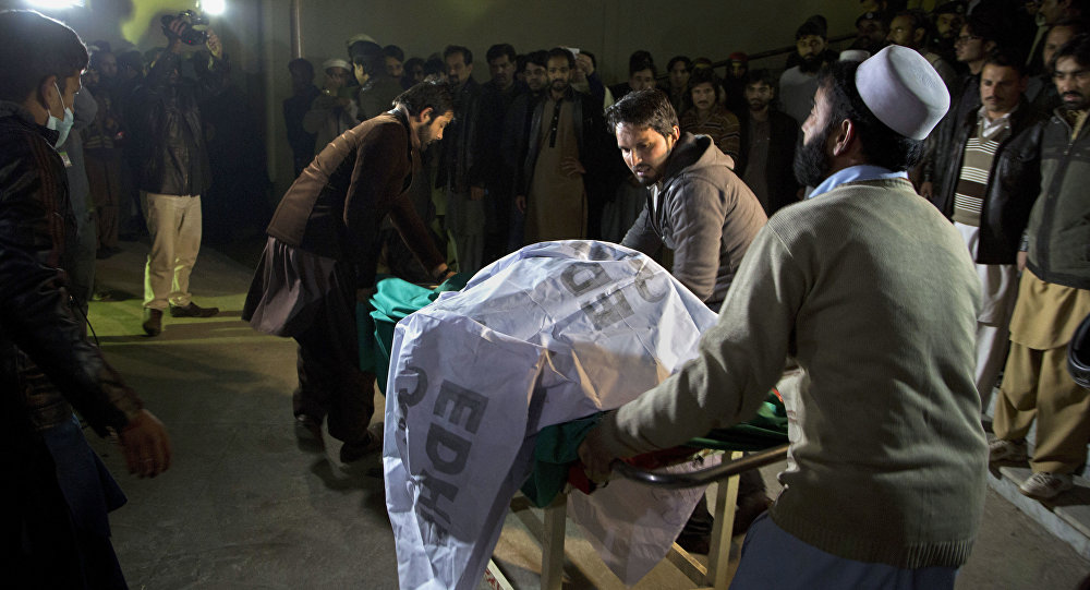 Pakistani volunteers move remains of plane crash victims to a mortuary at a hospital, in Abbottabad, Pakistan