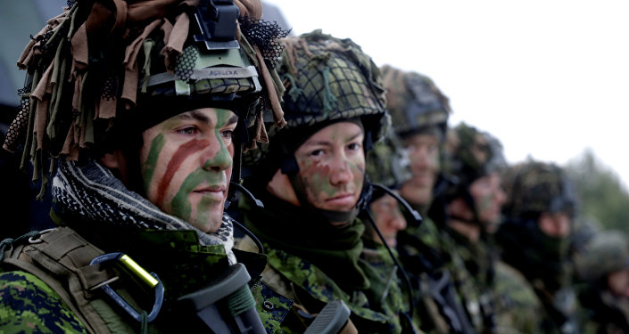 Lithuanian troops along with the other troops from 11 NATO nations take part in the exercise in urban warfare during Iron Sword exercise in the mock town near Pabrade, Lithuania, December 2, 2016.