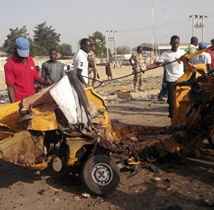 People clear debris after an explosion in Maiduguri, Nigeria (File)