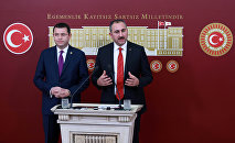 General Secretary of Turkish Justice and Development Party (AKP) Abdulhamit Gul (R) and Turkish Nationalist Movement Party's (MHP) deputy of Afyonkarahisar Mehmet Parsak (L) address a press conference at the Grand National Assembly of Turkey (TBMM) in Ankara on December 10, 2016, after a constitutional amendment bill was submitted to Turkish parliament