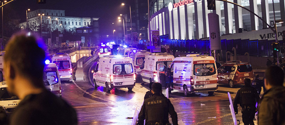Police officers and ambulances fill the street next to the Besiktas football club stadium, in Istanbul, late Saturday, Dec. 10, 2016. Two loud explosions have been heard near the newly built soccer stadium and witnesses at the scene said gunfire could be heard in what appeared to have been an armed attack on police.Turkish authorities have banned distribution of images relating to the Istanbul explosions within Turkey.