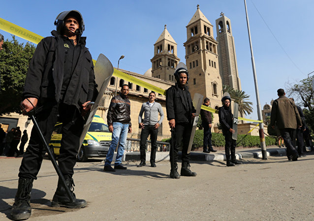 Members of the special police forces stand guard to secure the area around St. Mark's Coptic Orthodox Cathedral after an explosion inside the cathedral in Cairo, Egypt December 11, 2016