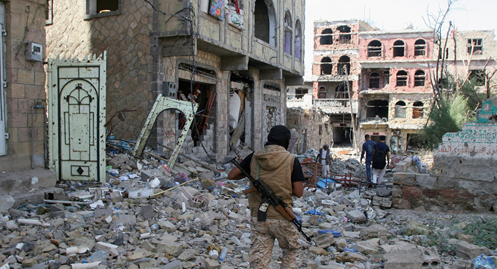 A pro-government fighter walks at the site of recent battles between Houthi fighters and pro-government troops , on the second day of a 48-hour ceasefire in the southwestern city of Taiz, Yemen November 20, 2016