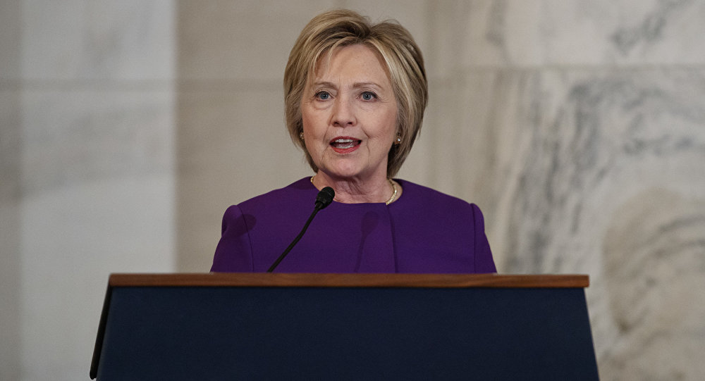 Former Secretary of State Hillary Clinton speaks during a ceremony to unveil a portrait of Senate Minority Leader Harry Reid, D-Nev., on Capitol Hill, Thursday, Dec. 8, 2016, in Washington