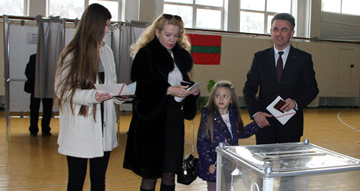 Supreme Council Chairman Vadim Krasnoselsky, his wife Svetlana and daughters at a polling station in Tiraspol during the presidential election in Transnistria