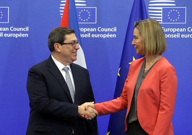 EU High Representative for Foreign Affairs Federica Mogherini (R) welcomes Cuban Foreign Minister Bruno Rodriguez Parrilla at the start of an EU-Cuba political dialogue and cooperation agreement in Brussels on December 12, 2016