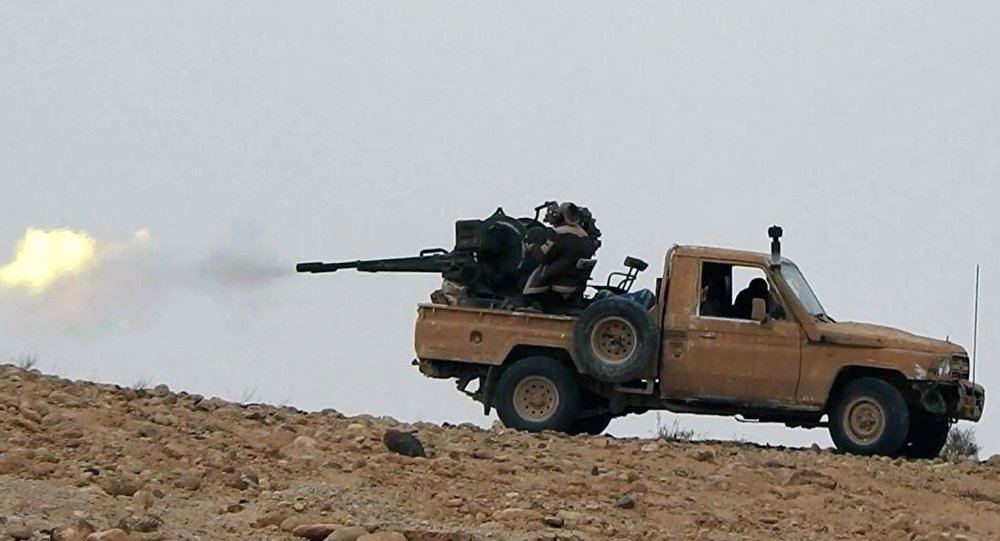 This image posted online on Saturday, Dec. 10, 2016, by supporters of the Daesh militant group on an anonymous photo sharing website, purports to show a gun-mounted vehicle operated by the group firing at Syrian troops north of Palmyra city, in Homs, Syria