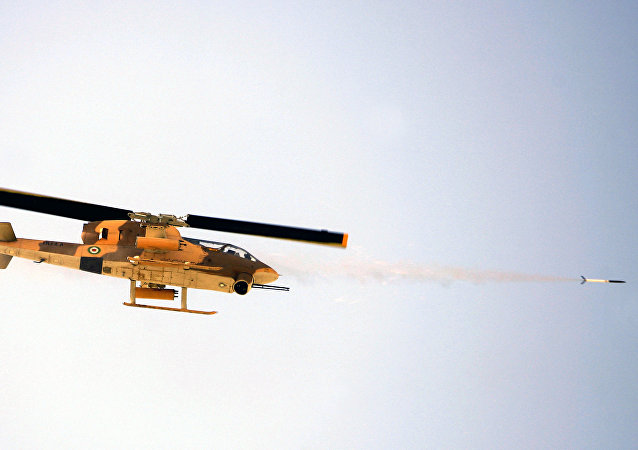 Iranian military helicopter fires a rocket during training maneuvers (File)