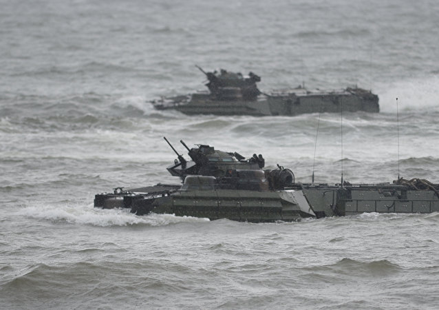 US marines Amphibious Assault vehicles (AAV) manoeuver on rough seas during a beach landing, as part of the Philippines-US amphibious landing exercise (PHIBLEX) at a naval training base facing South China sea in San Antonio town, Zambales province, north of Manila on October 7, 2016