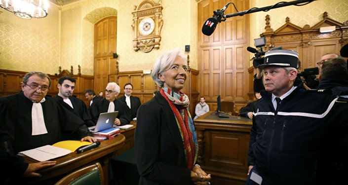 Managing Director of the International Monetary Fund (IMF) Christine Lagarde stands near her lawyer Patrick Maisonneuve (L) before the start of her trial about a state payout in 2008 to a French businessman, at the courts in Paris, France, December 12, 2016.