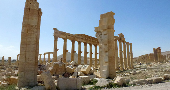 This file photo taken on March 27, 2016 shows a view of the remains of Arch of Triumph, also called the Monumental Arch of Palmyra, that was destroyed by Islamic State (IS) group jihadists in October 2015 in the ancient Syrian city of Palmyra
