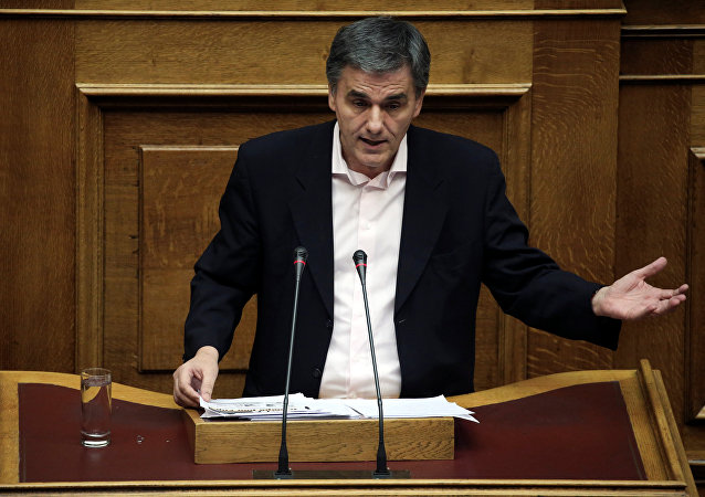 Greek Finance Minister Euclid Tsakalotos delivers a speech during a parliamentary session before a budget vote in Athens, Greece, December 10, 2016. Picture taken December 10, 2016