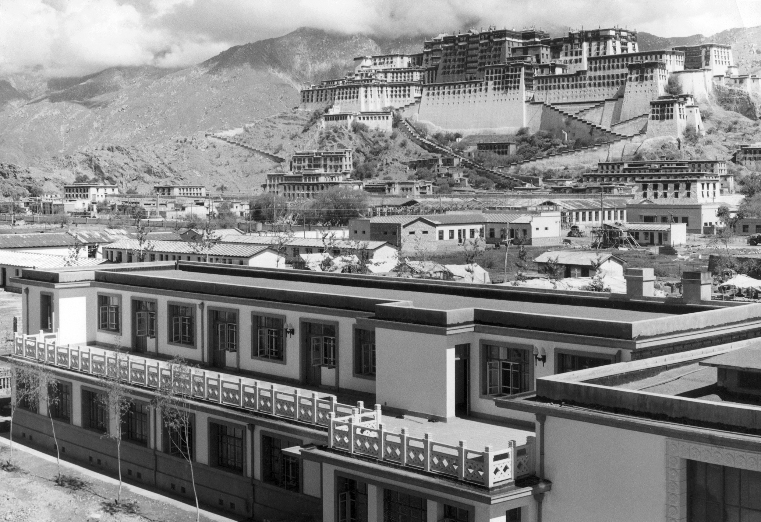 A picture released by Chinese official news agency in August 1965 with a caption saying: New buildings are going up at the foot of the Potala Palace (in the background, the former home of the Dalai Lama) in Lhasa