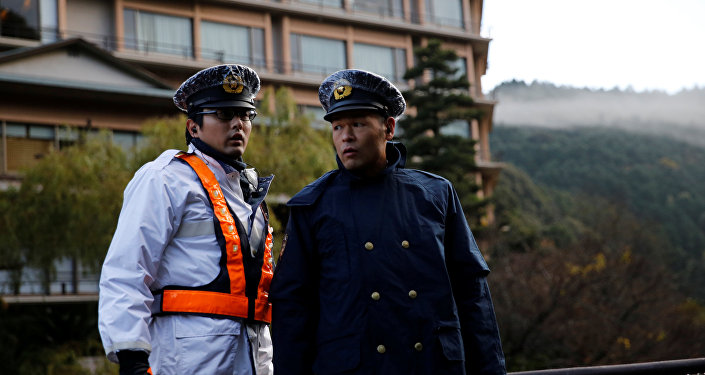 Police officers stand guard near a hot spring resort, the venue of the summit meeting between Japanese Prime Minister Shinzo Abe and Russian President Vladimir Putin, in Nagato, Yamaguchi prefecture, Japan, December 15, 2016
