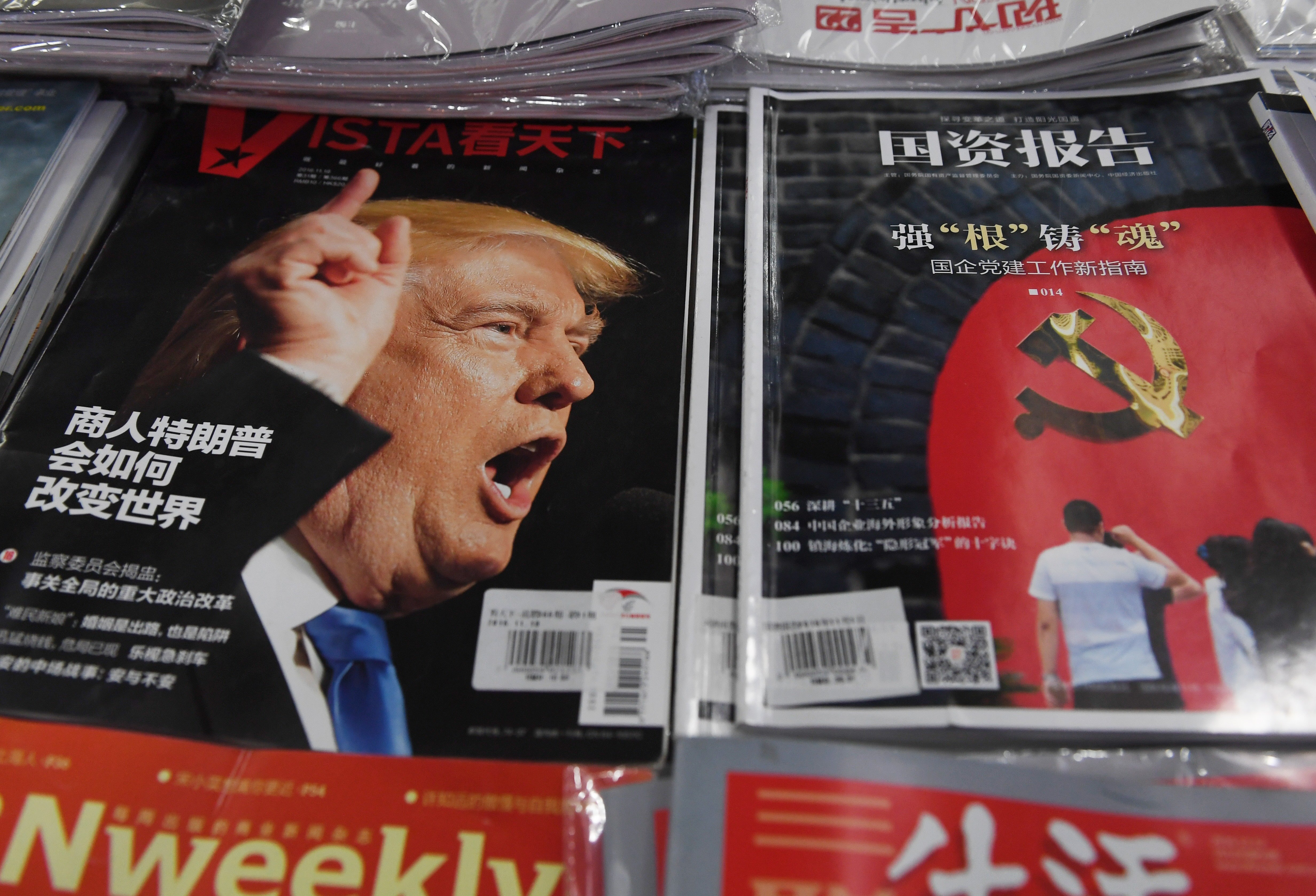 A magazine featuring US President-elect Donald Trump is seen at a bookstore in Beijing on December 12, 2016. The headline reads How will businessman Trump change the world