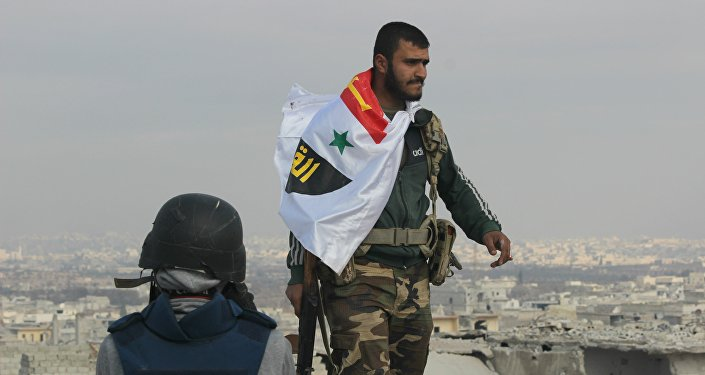 Picture of Syrian Arab Army soldier on rooftop of Sheikh Saeed in Eastern Aleppo the morning after full liberation from Nusra Front led militant factions.