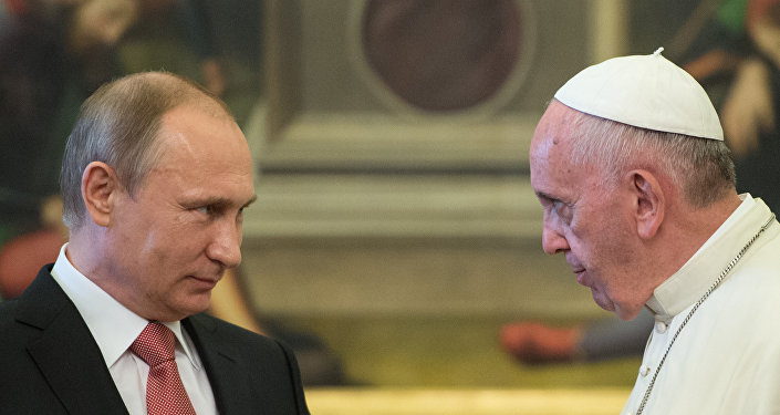 Russian President Vladimir Putin and Pope Francis during a meeting in Vatican on June 10, 2015