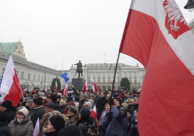 Protesters attend an anti-government demonstration, in Warsaw, Poland