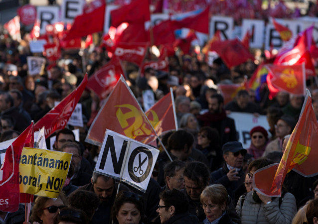 People march during a protest called by the main union against the government's austerity and social measures in Madrid, Spain December 18, 2016