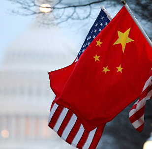 The People's Republic of China flag and the U.S. Stars and Stripes fly along Pennsylvania Avenue near the US Capitol during Chinese President Hu Jintao's state visit in Washington, DC, US on January 18, 2011.