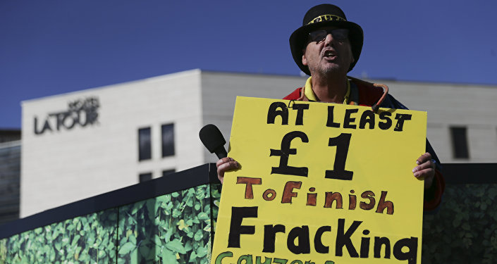 Anti-fracking (hydrolic fracturing) campaigner Gayzer Frackman is seen with a placard in Birmingham, central England, on October 2, 2016 on the first day of the Conservative party annual conference being held at Birmingham's International Convention Centre