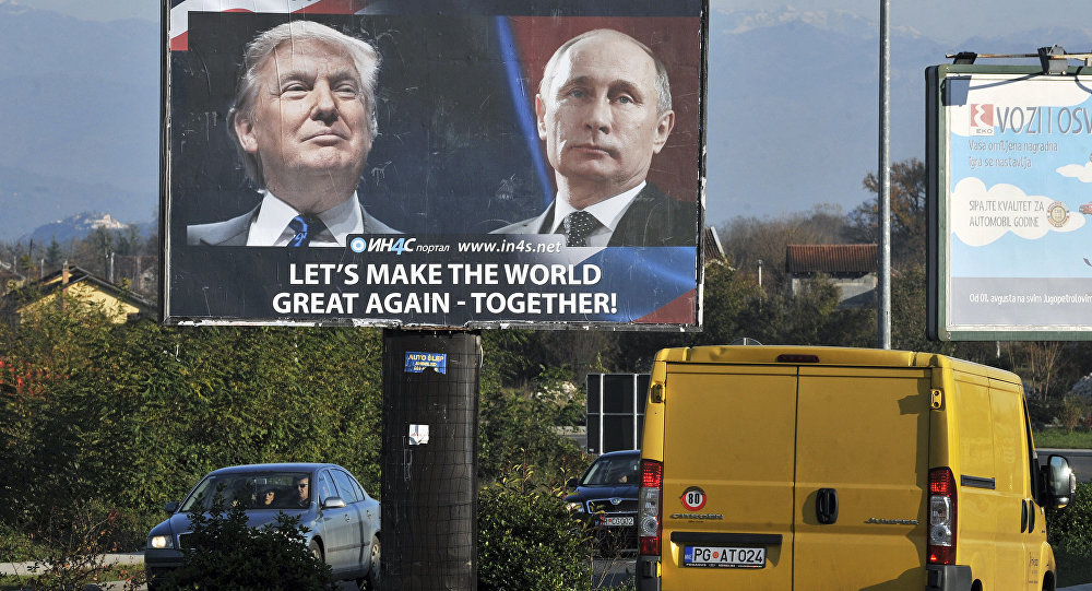 Cars pass by a billboard showing US President-elect Donald Trump and Russian President Vladimir Putin placed by pro-Serbian movement in the town of Danilovgrad on November 16, 2016
