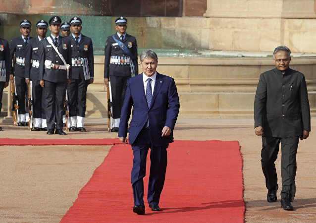 Kyrgyzstan President Almazbek Atambayev, returns after inspecting a joint services guard of honor during his ceremonial reception at the presidential palace, in New Delhi, India, Tuesday, Dec. 20, 2016