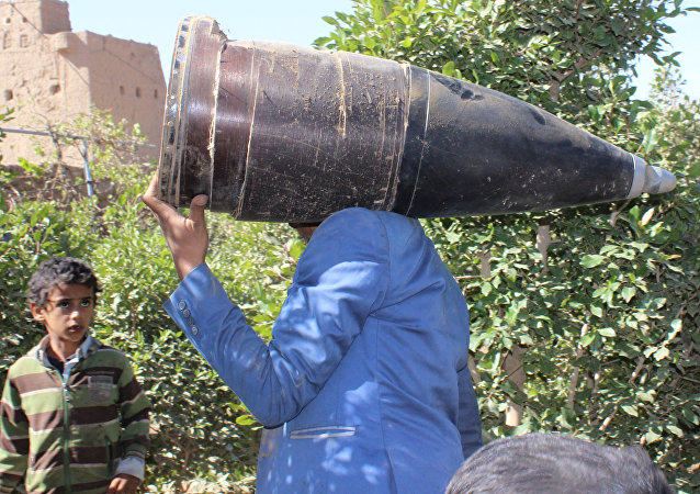 A man carries a part of a missile he says was dropped during a Saudi-led air strike near the northwestern city of Saada, Yemen December 7, 2016.