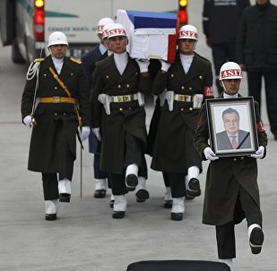 Flag-wrapped coffin of late Russian Ambassador to Turkey Andrei Karlov is carried to a plane during a ceremony at Esenboga airport in Ankara, Turkey, December 20, 2016