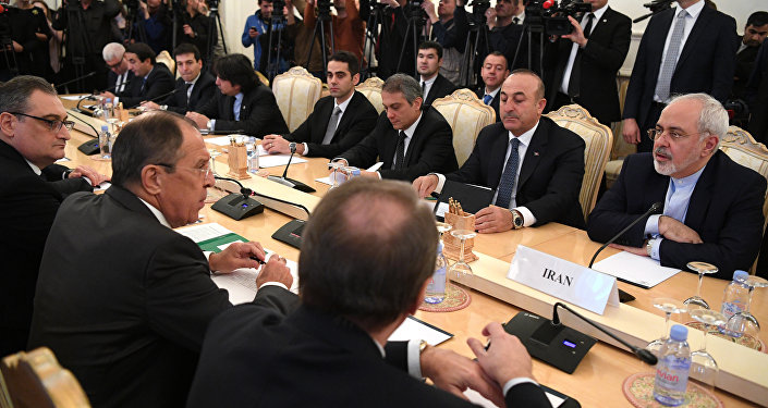 Russian Foreign Minister Sergei Lavrov (2L), his Turkish counterpart Mevlut Cavusoglu (2R) and Iran's Foreign Minister Mohammad Javad Zarif (R) attend a meeting in Moscow on December 20, 2016