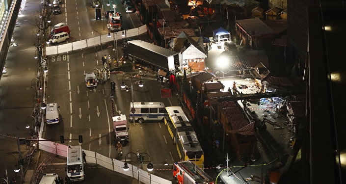 Authorites inspect a truck that had sped into a Christmas market in Berlin, on December 19, 2016