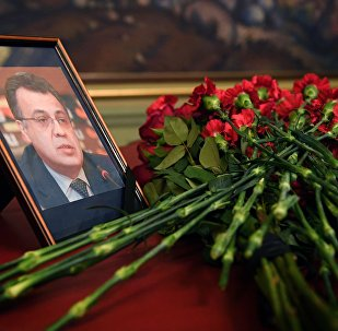 Flowers are placed in front of a portrait of Russian Ambassador to Turkey Andrei Karlov in the Foreign Ministry in Moscow a day after the assassination of the Russian ambassador in the Turkish capital