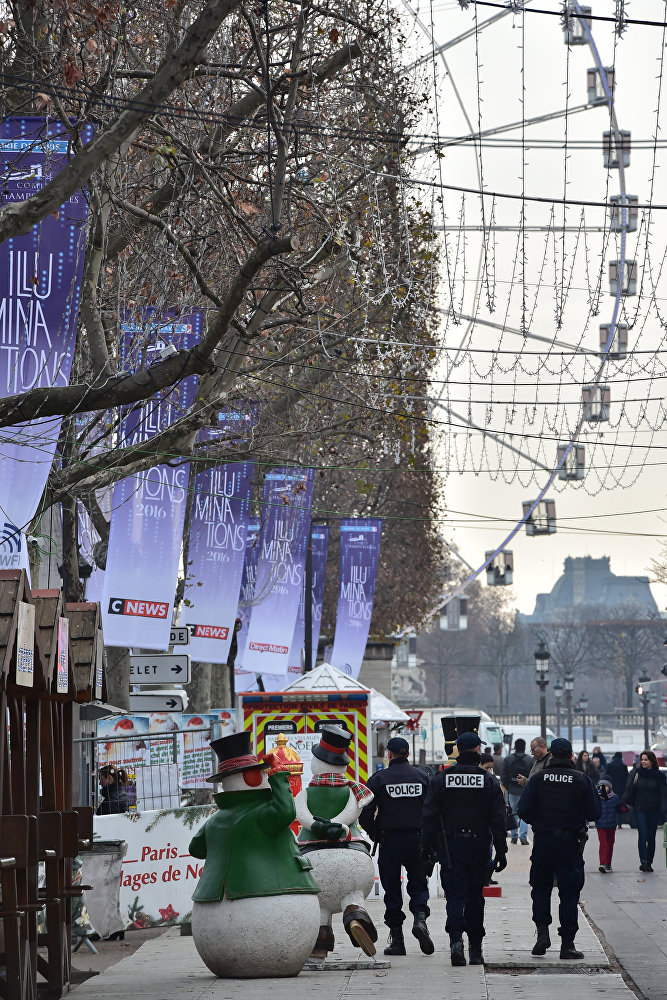 French police officers secure a Christmas market on the Champs Elysees avenue in Paris