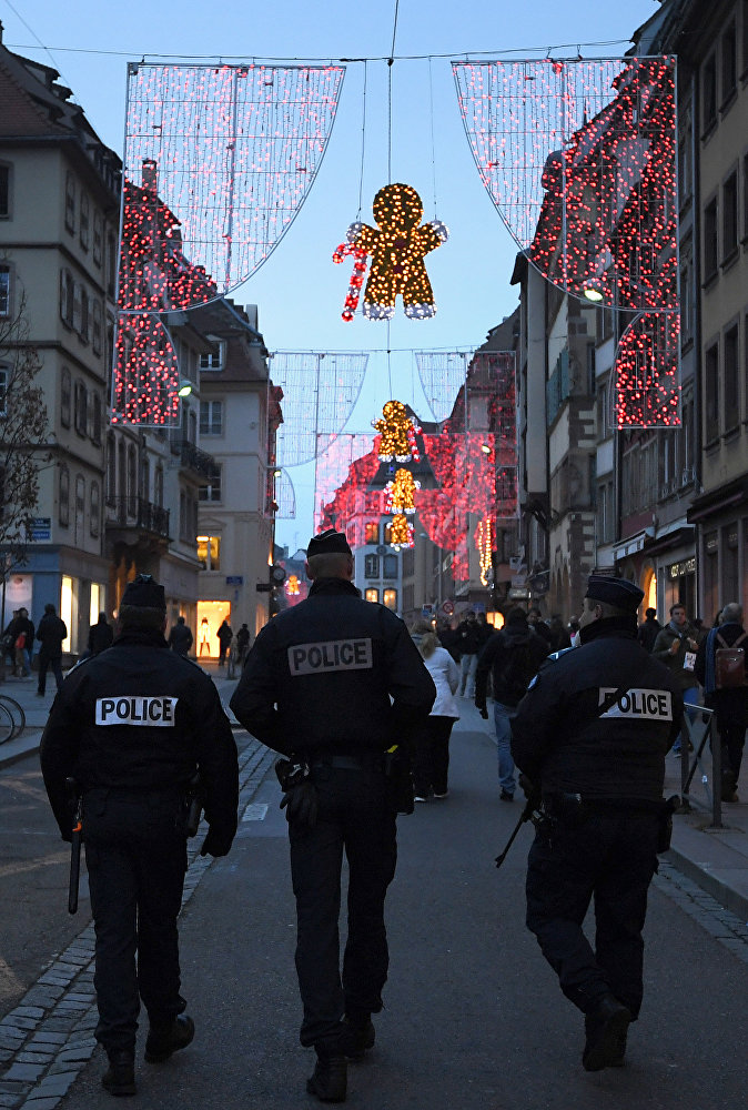 Police officers patrol at the entrance of the Christmas market in Strasbourg, eastern France