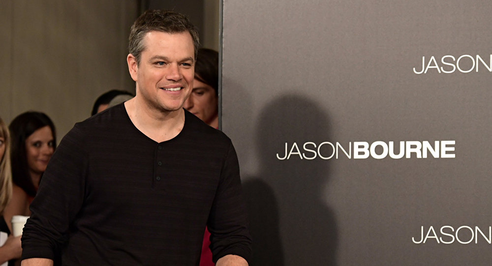 US actor Matt Damon arrives to receive a football and jersey from Club Atletico de Madrid during a promotional event for