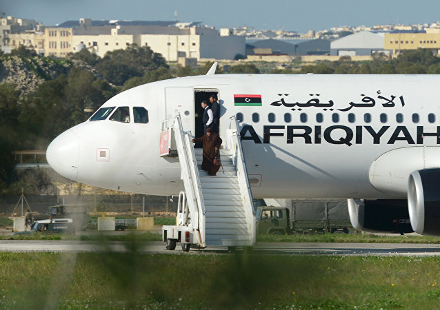 Group of hostages being released from the Afriqiyah Airways A320 after it was hijacked from Libya