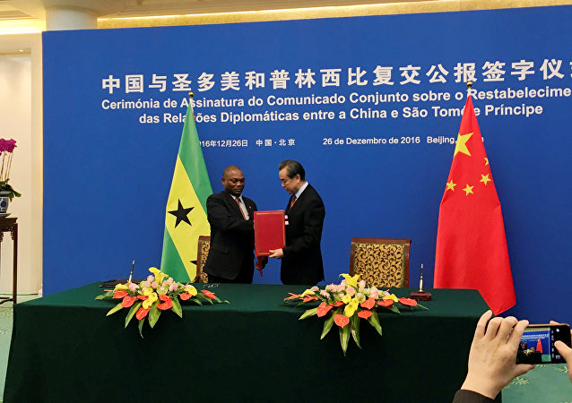China's Foreign Minister Wang Yi and Sao Tome and Principe's Foreign Minister Urbino Botelho attend a signing ceremony for China and Sao Tome and Principe to establish official relations, in Beijing, China, December 26, 2016