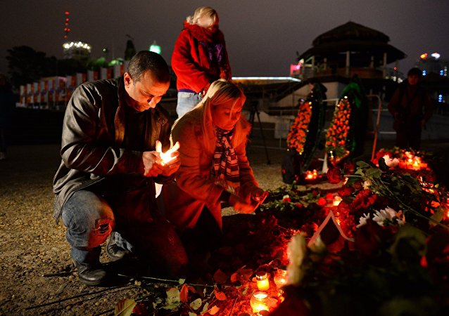 City residents attend a vigil in Sochi where a Russian Defense Ministry's TU-154 airplane crashed off the Black Sea coast