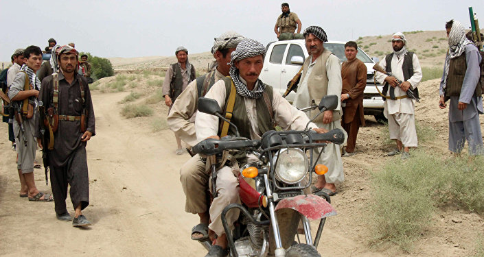 This photograph taken on August 1, 2015, shows members of Afghanistan's militia forces gathering in the Qala-e Zal district of Kunduz province