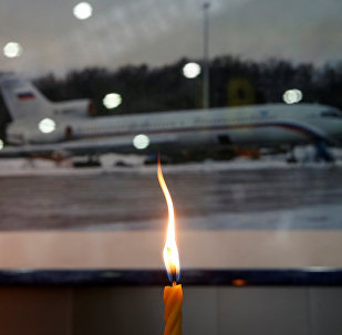 A candle is placed in front of a picture of Tu-154 plane, to commemorate passengers and crew members of Russian military plane, which crashed into the Black Sea on its way to Syria on Sunday, at the Sochi International Airport (Sochi-Adler Airport) in the Black Sea resort city of Sochi, Russia, December 26, 2016