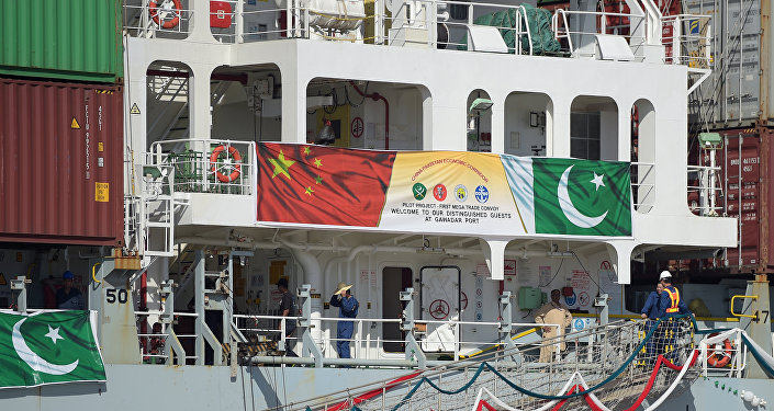In this photograph taken on November 13, 2016, Pakistani personnel stand on a ship carrying containers at the Gwadar port, some 700 kms west of Karachi, during the opening ceremony of a pilot trade programme between Pakistan and China