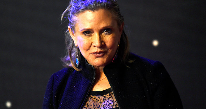 FILE PHOTO: Carrie Fisher poses for cameras as she arrives at the European Premiere of Star Wars, The Force Awakens in Leicester Square, London, December 16, 2015